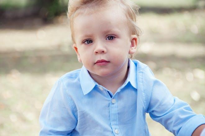 little boy in blue shirt outside