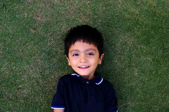 little boy on grass