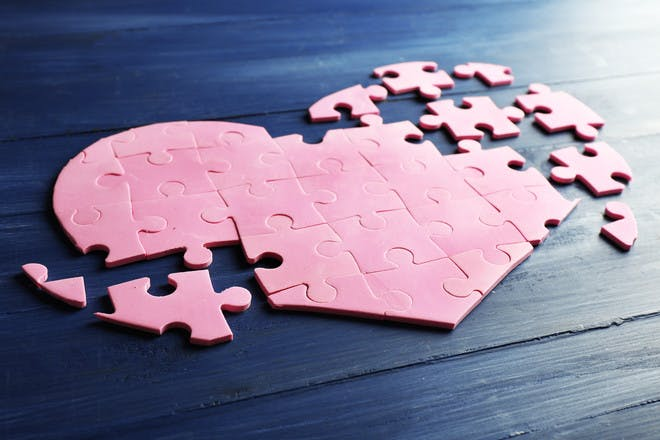 pink heart puzzle pieces