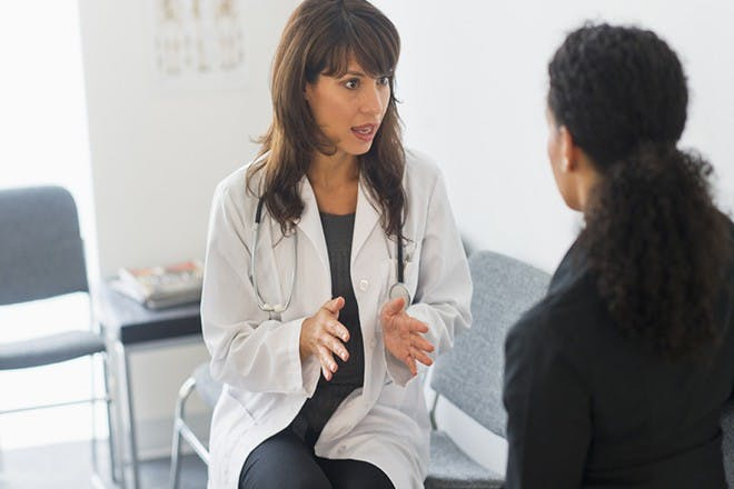 woman and doctor speaking