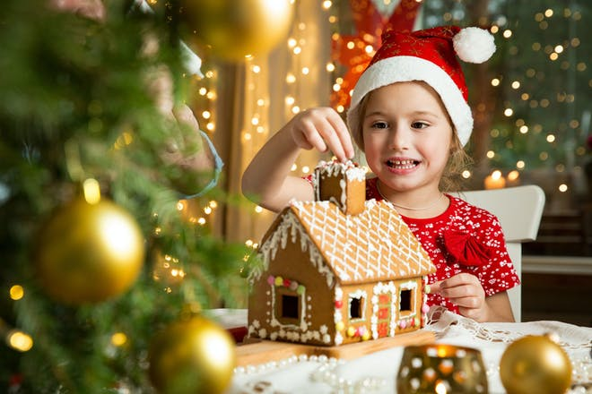 Little girl with gingerbread house