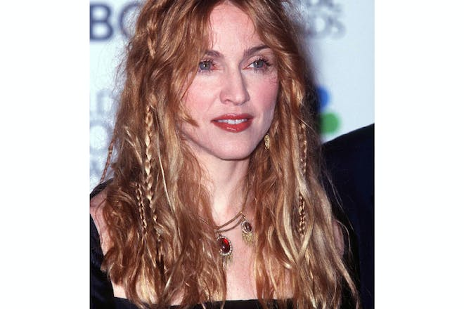 Madonna in 1998 with hair plaits