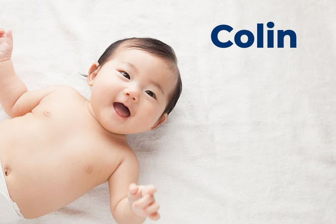 Baby smiling at camera. Name Colin written in text