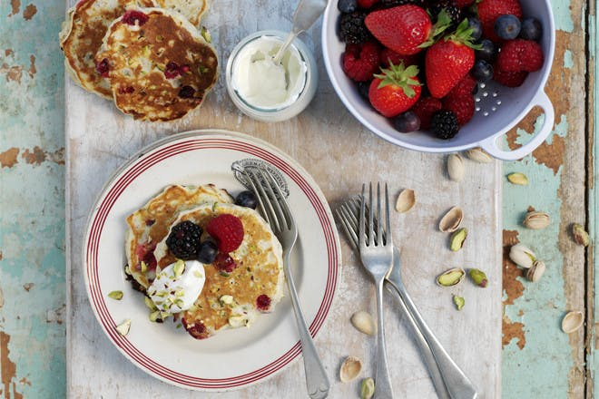 Oat and pistachio pancakes with fresh berries. Healthy pancakes recipe