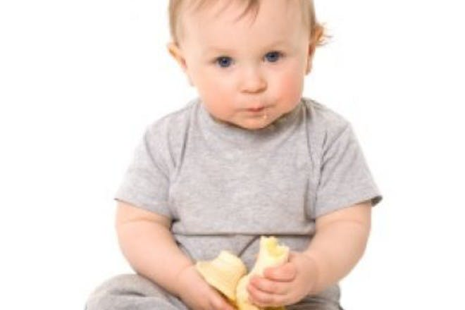 baby eating banana