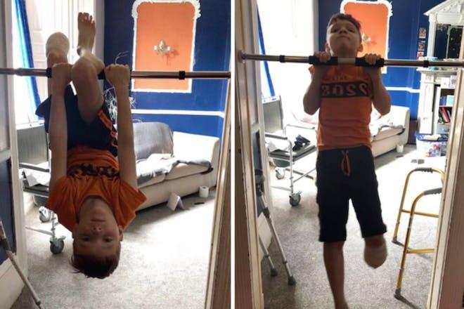 Max Clark swinging on his bars