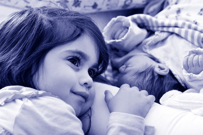 little girl with new baby sibling