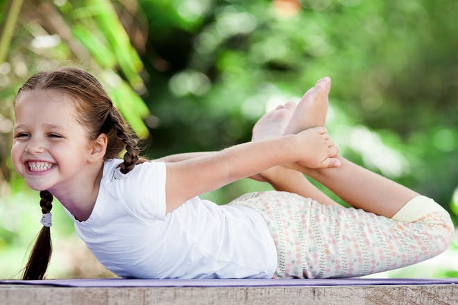 Young girl doing yoga move