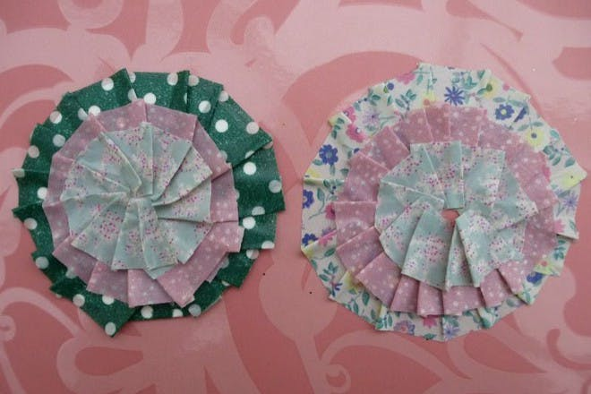 colourful washi corsages on patterned background