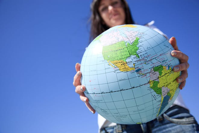 Teenager holding globe