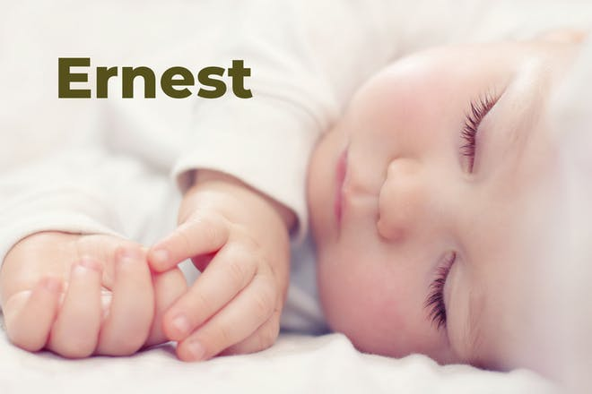Close up of sleeping baby with name Ernest written in text