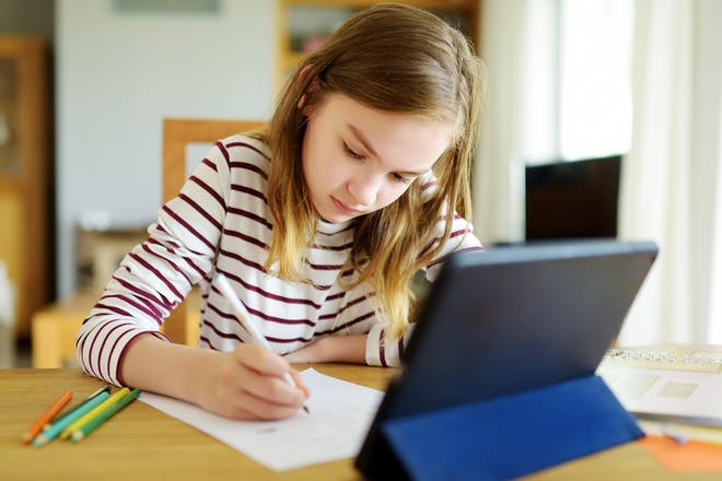 Girl doing schoolwork at home