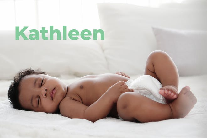 Baby sleeping in nappy. Name Kathleen written in text
