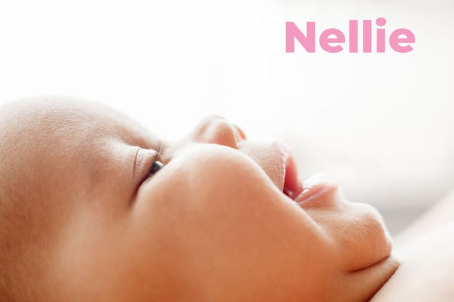 Close up of baby's face. Name Nellie written in text