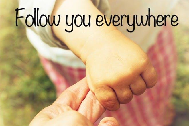 child holding mum's hand