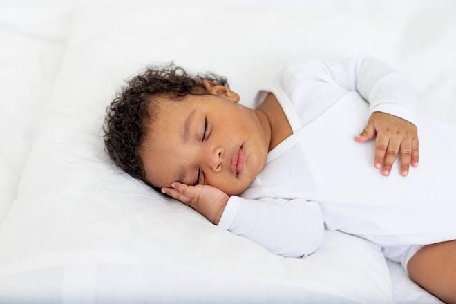 Sleeping baby wearing white