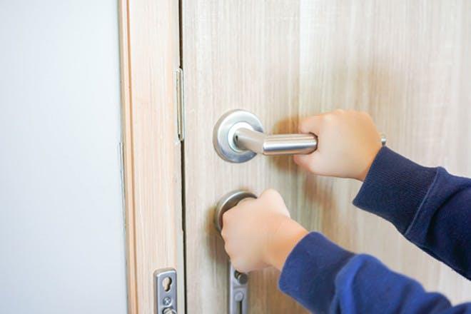Child hands opening door