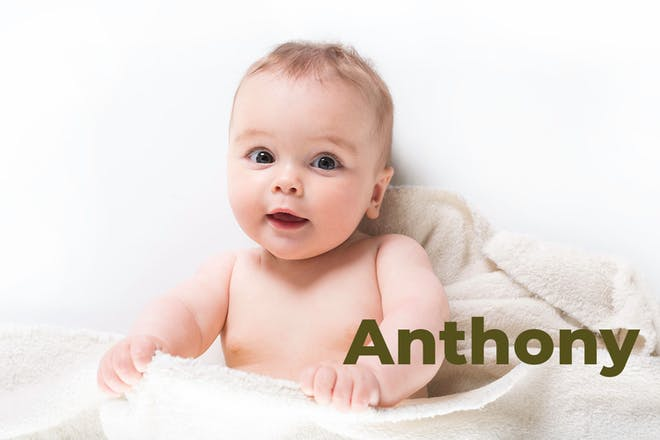 Baby sitting up in blanket. Name Anthony written in text