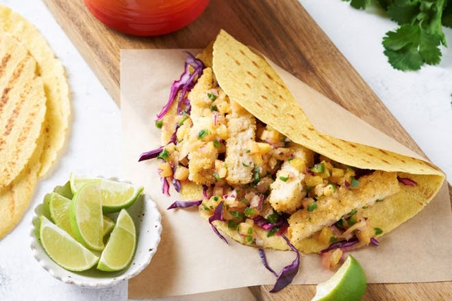 Breaded vegan fish fillets in tacos with pineapple salsa