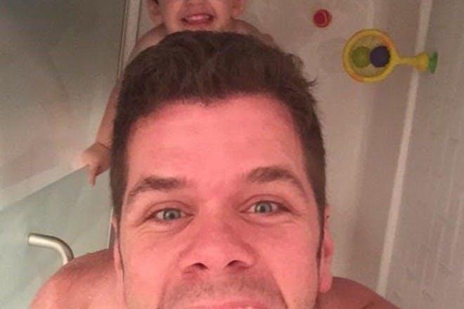 Perez Hilton in bath with son