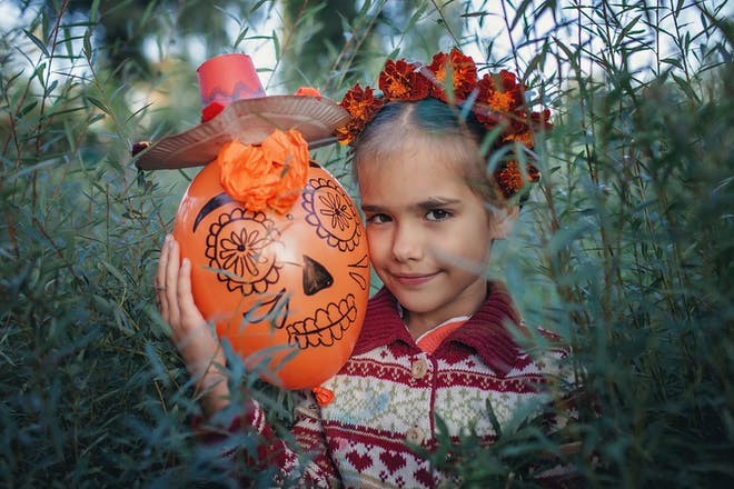 Little girl with a flower crown and day of the dead decoration