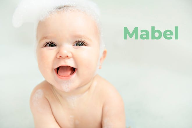 Baby in bath with bubbles on head. Name Mabel written in text