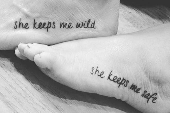 She keeps me safe/ she keeps me wild tattoo