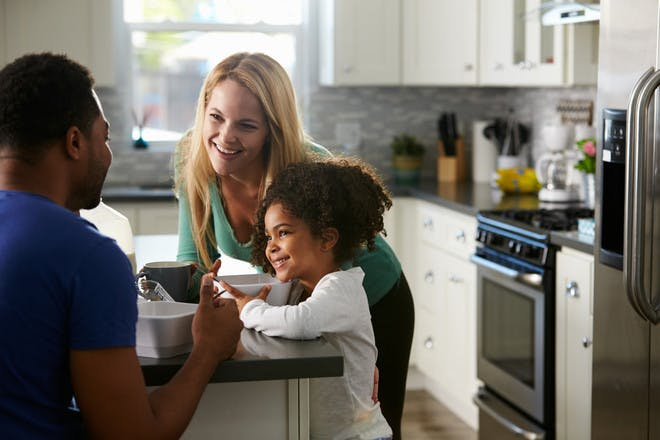 Family chatting in kitchen