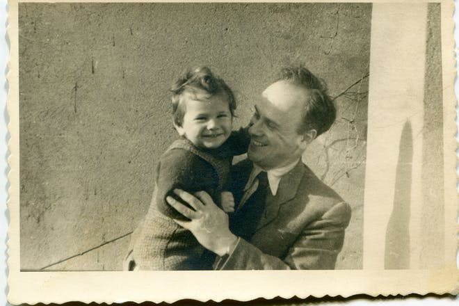 Black and white vintage family photo of dad holding toddler daughter