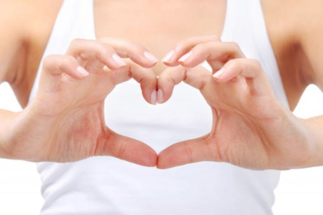 woman making heart with fingers