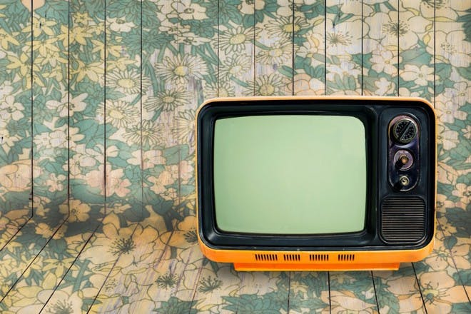 old television on patterned background