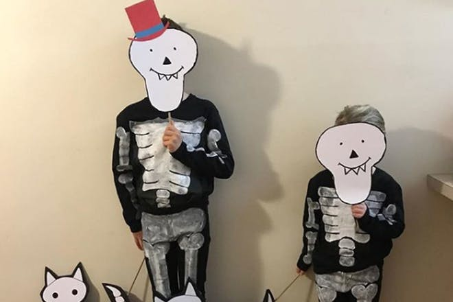 Two little boys dressed as skeletons