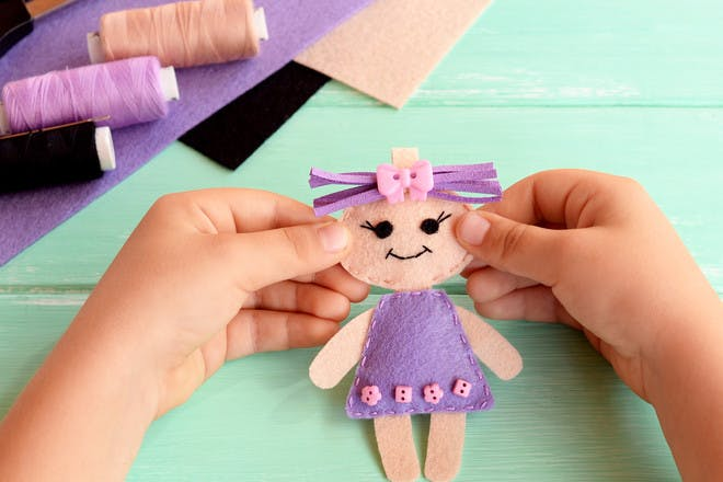 Child's hands making crafts