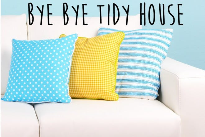 blue and yellow cushions on sofa