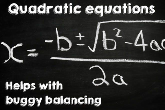 maths equation written in chalk on black chalk board