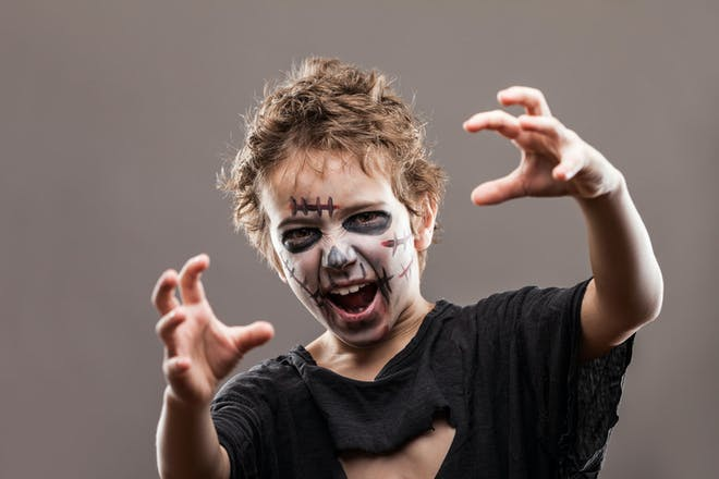 Little boy dressed as a zombie