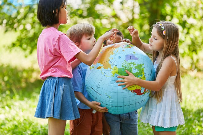 Group of kids looking at blow-up globe