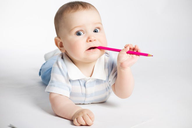 Baby chewing on pencil