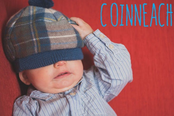 baby with hat over eyes