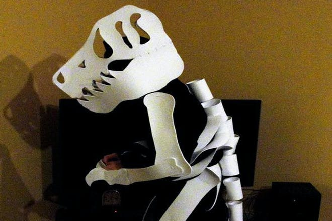 A child dressed as dinosaur bones