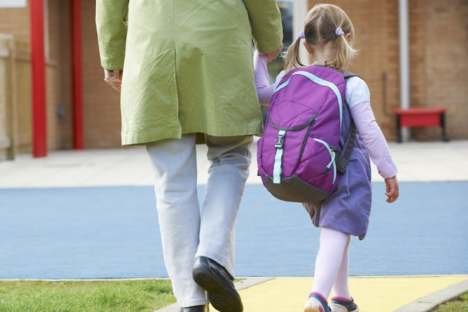 Parent and child with rucksack