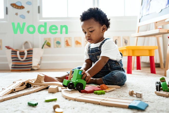 Baby boy playing with toys