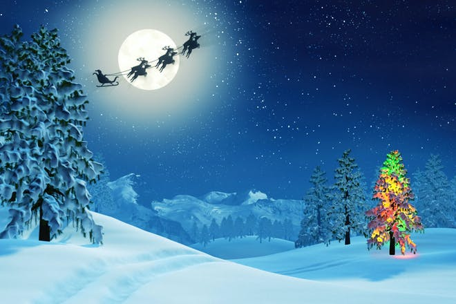Santa and his reindeer flying through the sky