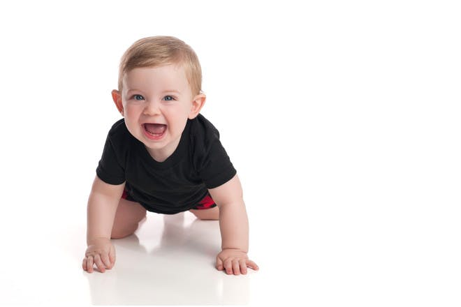 baby in black t-shirt