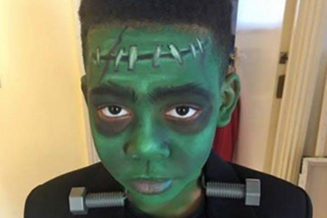 A boy dressed as Frankenstein