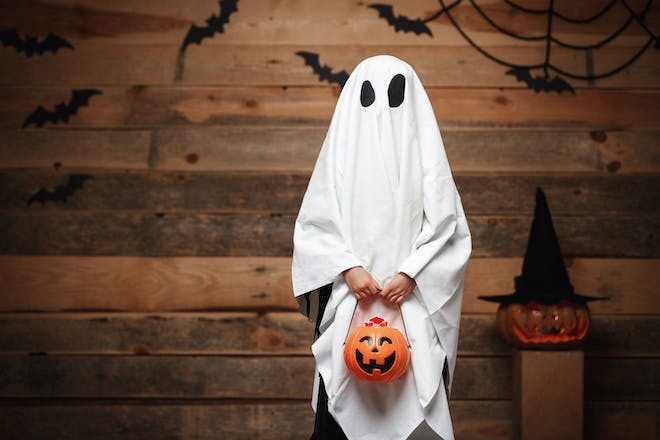 A kid dressed as a ghost