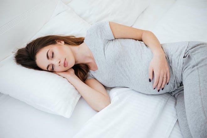 Pregnant woman sleeping on side