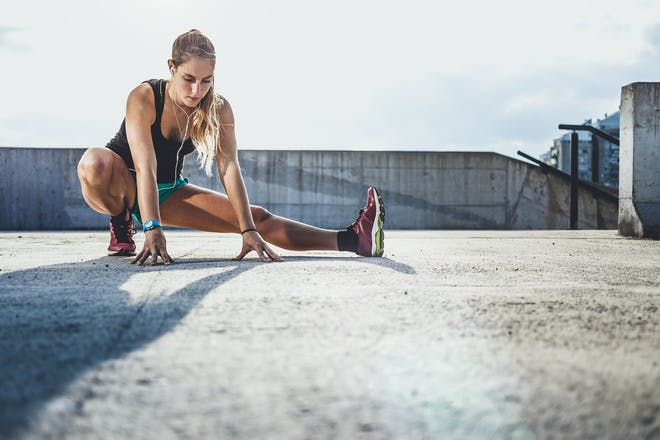 Woman stretching to warm up