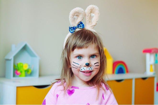 Easter face painting on little girl