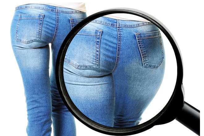 Woman's bum with magnifying glass